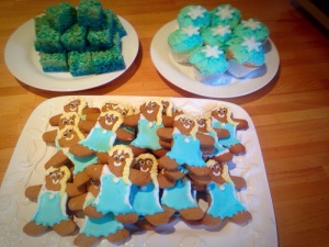 So many Elsa's! Some Rice Krispie squares and cupcakes in the background for good measure